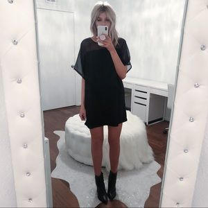 Black dress with sheer top panel
